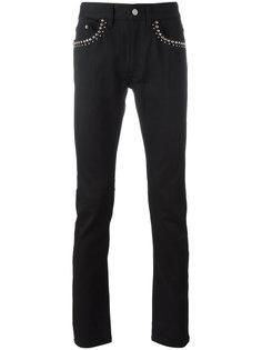 джинсы с заклепками Roberto Cavalli