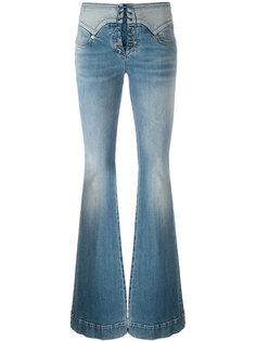 расклешенные джинсы со шнуровкой Roberto Cavalli