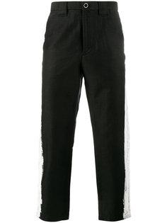 брюки с контрастными полосками по бокам Maison Mihara Yasuhiro