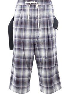 checked drop-crotch trousers Maison Mihara Yasuhiro