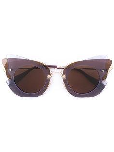 cat eye shaped sunglasses Miu Miu Eyewear