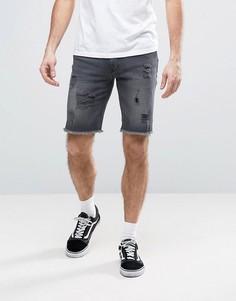 Черные джинсовые шорты скинни с рваной отделкой ASOS - Черный