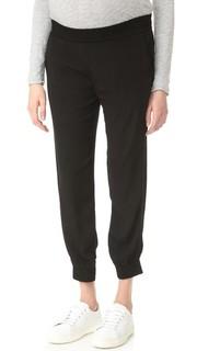 Узкие спортивные брюки из крепа для беременных Monrow