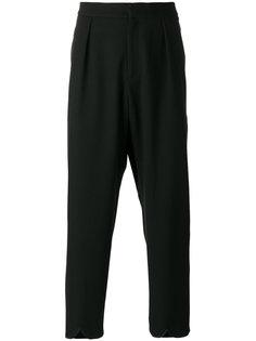 брюки с волнистыми манжетами J.W.Anderson