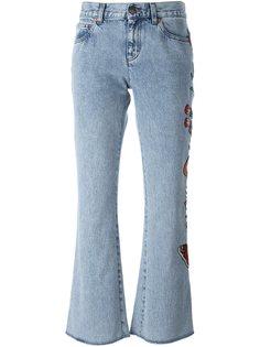 расклешенные джинсы с цветочной вышивкой Gucci