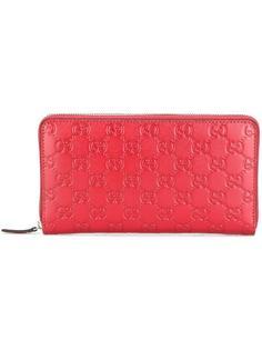 кошелек Gucci Signature с круговой молнией Gucci