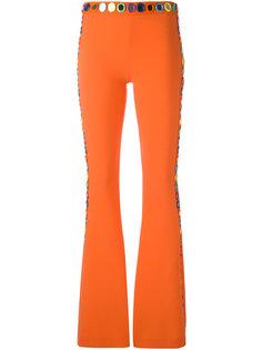 расклешенные декорированные брюки Moschino