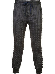 pleated track pants  Issey Miyake