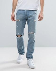 Светлые джинсы скинни с прорехами Hollister - Синий