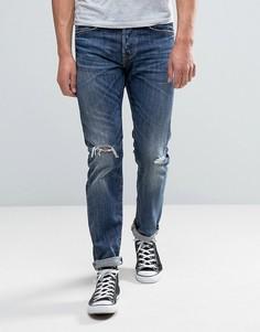 Суженные книзу темные джинсы с рваной отделкой Edwin ED-80 - Синий