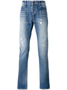джинсы с рваными деталями Saint Laurent