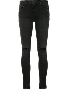 джинсы скинни с рваными деталями Etienne Marcel