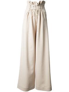 расклешенные брюки палаццо The Row