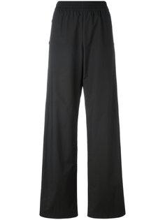 брюки палаццо на пуговицах Maison Margiela