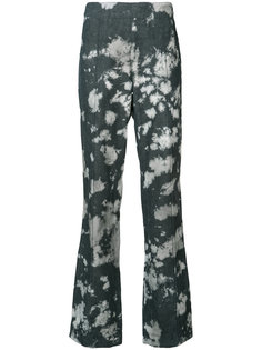 stained flared trousers Victor Alfaro
