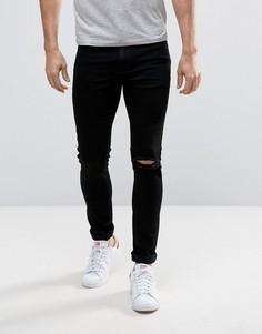 Черные супероблегающие джинсы с рваной коленкой ASOS - Черный