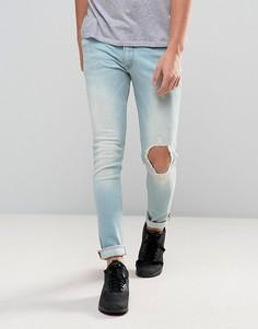 Голубые выбеленные джинсы скинни с рваной отделкой ASOS - Синий