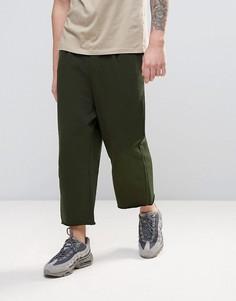 Джоггеры цвета хаки с заниженным шаговым швом и широкими штанинами ASOS - Зеленый