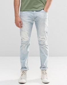 Суженные книзу выбеленные джинсы с заплатками Wrangler Boyton - Синий