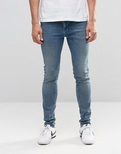 Синие зауженные джинсы в винтажном стиле ASOS - Синий