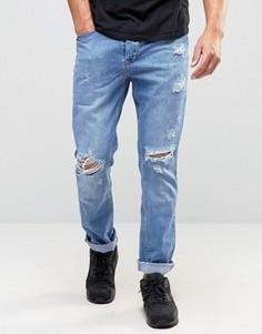Суженные книзу джинсы с прорехами Kubban - Синий