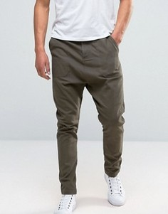 Штаны цвета хаки с заниженным шаговым швом ASOS - Зеленый