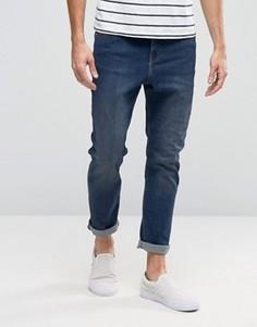 Суженные книзу синие джинсы с заниженным шаговым швом Cheap Monday - Синий