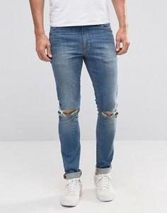 Синие супероблегающие джинсы с рваными коленками ASOS - Синий