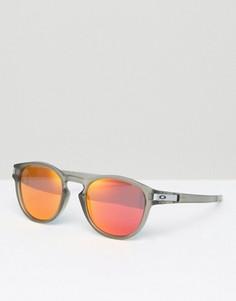 Солнцезащитные очки в круглой оправе Oakley - Прозрачный
