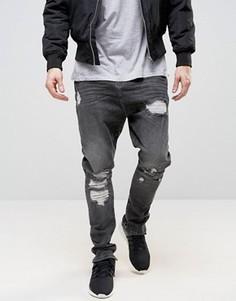Черные выбеленные джинсы с рваной отделкой и заниженным шаговым швом ASOS - Черный
