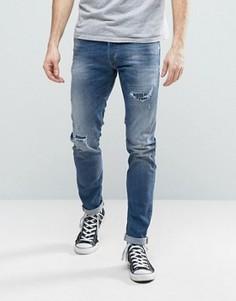 Выбеленные джинсы скинни с потертостями и заплатками Diesel Sleenker 679C - Синий