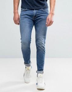 Суженные книзу джинсы узкого кроя с эффектом поношенности Edwin ED-85 - Синий