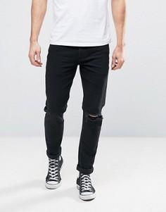 Черные джинсы скинни с прорехой на одном колене ASOS - Черный