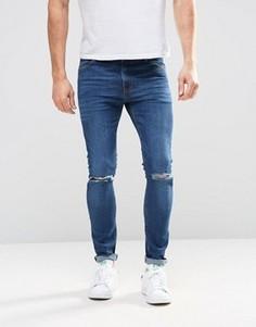 Ультразауженные джинсы скинни с рваными коленями ASOS - Синий