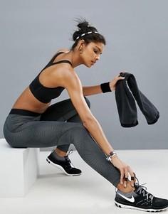 Серые леггинсы с принтом Nike - Серый