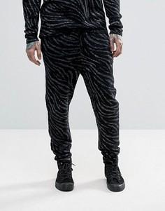 Трикотажные брюки с отделкой зебра металлизированной нитью ASOS - Черный