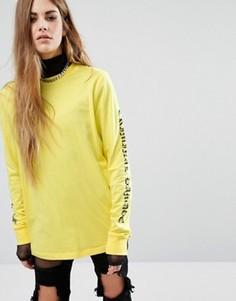 Свободный лонгслив с текстовым принтом на рукавах Criminal Damage - Желтый
