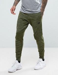 Суженные книзу зеленые трикотажные джоггеры Nike Tech 832180-331 - Зеленый