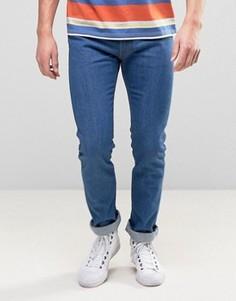 Синие джинсы слим с оранжевым логотипом Levis 505C - Синий Levis®