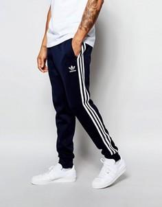 Спортивные штаны с кромкой манжетом adidas Originals Superstar AJ6961 - Синий