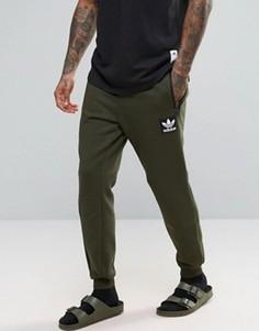 Зеленые джоггеры adidas Originals AY9302 - Зеленый