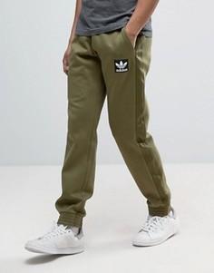 Зеленые джоггеры adidas Originals AY9303 - Зеленый