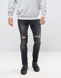 Черные выбеленные джинсы скинни с прорехами ASOS - Черный