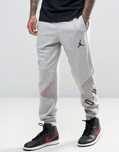 Джоггеры с крупным логотипом Nike Jordan 833920-063 - Серый