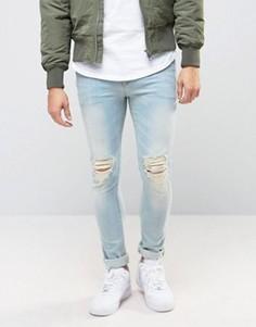 Голубые выбеленные супероблегающие джинсы с рваными коленками ASOS - Синий