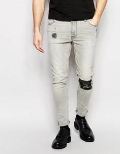 Супероблегающие джинсы с принтом в области колена ASOS - Серый