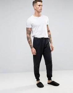 Джоггеры кроя слим с манжетами Calvin Klein - Черный