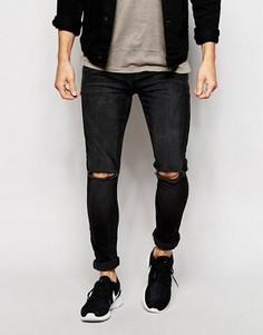 Супероблегающие рваные джинсы ASOS - Черный