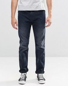 Темные суженные книзу джинсы слим Levis Line 8 522 - Синий