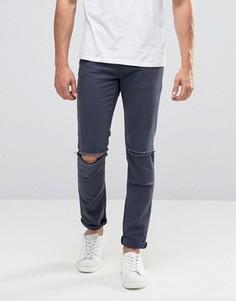 Темно-синие супероблегающие джинсы с рваными коленями ASOS - Синий